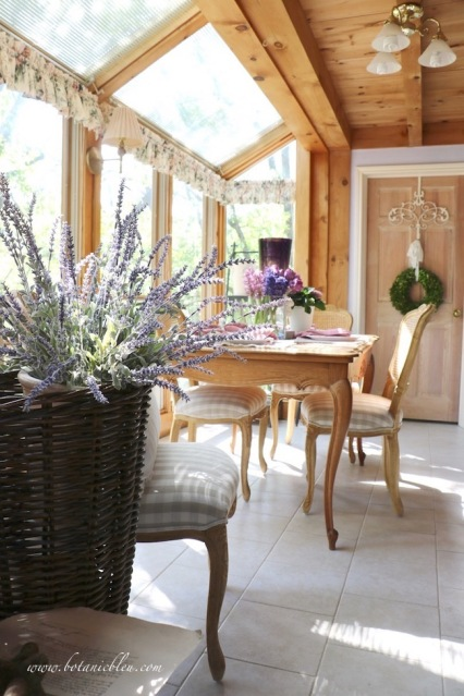 French lavender in a French market basket in a French-inspired garden and home with posts and beams